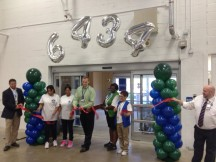Store Manager Brian Rising cuts the ribbon